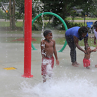 William Moore | BUY at PHOTOS.DJOURNAL.COM<br /> Jaron Jefferson, 6, of Shannon, reacts to a bucket of water splashing on his head at the new splash pad at Shannon City Park.