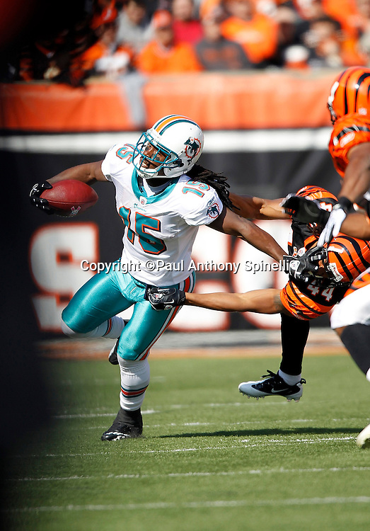 Miami Dolphins wide receiver Davone Bess (15) runs away from a tackle attempt during the NFL week 8 football game against the Cincinnati Bengals on Sunday, October 31, 2010 in Cincinnati, Ohio. The Dolphins won the game 22-14. (©Paul Anthony Spinelli)
