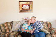 "Charles Stover, 81, of Amesville, Ohio, kisses his girlfriend Joan Allbaugh after seeing the photographer's camera pointed toward him at his home in Amesville, Ohio, Nov. 11, 2011. The couple started dating several months after Stover's wife of 62 years passed away in January of 2011, though Allbaugh had not dated anyone else since her husband passed away in 1989. Stover said, ""I just never thought at my age that it would ever happen again."""