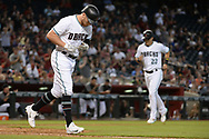 PHOENIX, AZ - AUGUST 15:  Brandon Drury #27 of the Arizona Diamondbacks is walked as Jake Lamb #22 scores in the fourth inning against the Houston Astros at Chase Field on August 15, 2017 in Phoenix, Arizona.  (Photo by Jennifer Stewart/Getty Images)