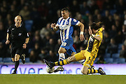 Fulham defender Richard Stearman (5) and Brighton striker, Tomer Hemed (10) during the Sky Bet Championship match between Brighton and Hove Albion and Fulham at the American Express Community Stadium, Brighton and Hove, England on 15 April 2016.