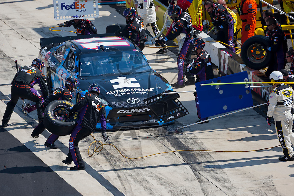 DOVER, DE - JUN 03, 2012:  Denny Hamlin (11) races during the FedEx 400 Benefiting Autism Speaks at the Dover International Speedway in Dover, DE.