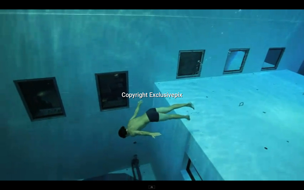How does he hold his breath for so long? Stunning video shows free-diver plunging 33m to bottom of world's deepest pool<br /> <br /> Stunning footage shows daredevil free-diver Guillaume N&eacute;ry plummeting to the depths of the world's deepest swimming pool.<br /> The astonishing video sees the 29-year-old plunging, without any breathing equipment whatsoever, a staggering 33metres to the bottom of the NEMO 33.<br /> The venue, in central Brussels, Belgium, contains 2.5million litres of non-chlorinated spring water and is usually reserved for scuba drivers to train in.<br /> <br /> With its simulated underwater caves, and constant toasty temperatures, it provides the perfect place for budding divers to gain their qualifications.<br /> <br /> For French-born N&eacute;ry the dive would have been a welcome change from his usual escapades in harbours across the world.<br /> <br /> <br /> <br /> The constant-weight free-diving specialist broke the world record in 2002 by descending 87metres in the Villefranche-sur-Mer harbour, in Alpes-Maritimes, France.<br /> And in 2004, he plunged 96metres in Saint-Leu, la R&eacute;union, before battering the record again in 2006 with a 109metre dive in Nice, France.<br /> His feat has subsequently been beaten by two other divers, with Herbert Nitsch currently holding the title with 124metres.<br /> &copy;Exclusivepix