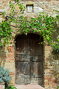 Ancient doorway and religious painting at Il Rigo agritourismo hotel and farmhouse, San Quirico d'Orcia, in Val D'Orcia area Tuscany, Italy