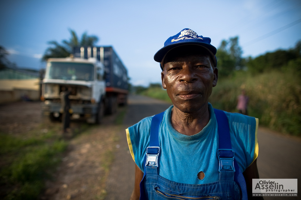 A truck driver stands near his truck outside Kpalime, Togo on Friday September 11, 2009.