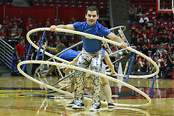 12 January 2011:Members of the Gamma Phi Circus perform a routine on the human wheel  during an NCAA Missouri Valley Conference men's basketball game between the Northern Iowa Panthers and the Illinois State Redbirds at Redbird Arena in Normal Illinois.