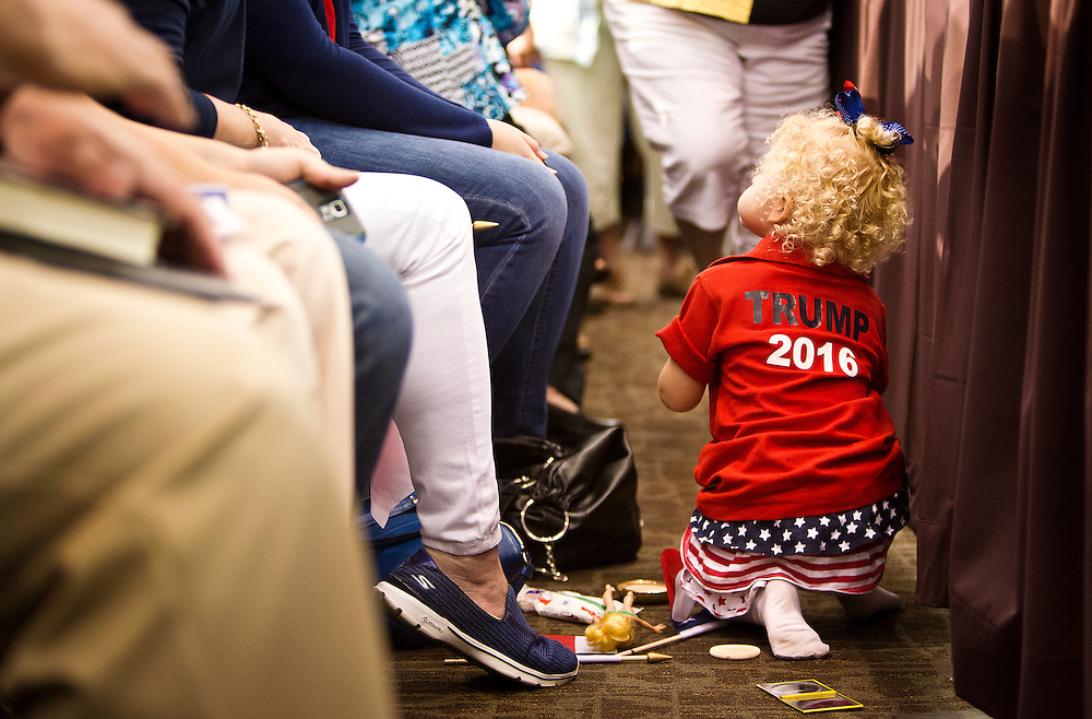 """A young Donald Trump supporter waits for the Republican candidate's """"Make America Great Again Rally"""" at the Grand River Center in Dubuque, Iowa, Tuesday, August 25, 2015. REUTERS/Ben Brewer"""