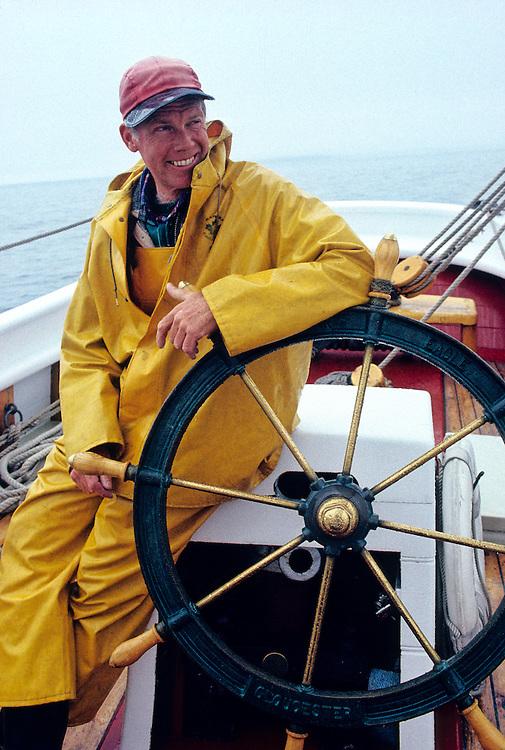 SAILING. Schooner Captain at the helm Coast of Maine
