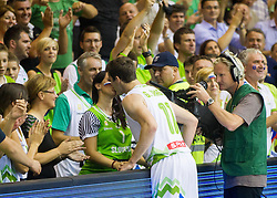 Goran Dragic of Slovenia with his wife celebrate after Slovenia won during basketball match between National teams of Slovenia and Spain in Round 1 at Day 2 of Eurobasket 2013 on September 5, 2013 in Arena Zlatorog, Celje, Slovenia. (Photo by Vid Ponikvar / Sportida.com)