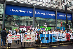 London, UK. 22 November, 2019. Climate activists from Scientists for XR gather outside the Department of Business, Energy and Industrial Strategy during a demonstration intended to communicate the science relating to the climate and ecological emergency. Activists were dressed in labcoats to represent the 1600 scientists worldwide who have signed the Scientists Declaration in support of non-violent direct action against government inaction against the climate and ecological emergency.