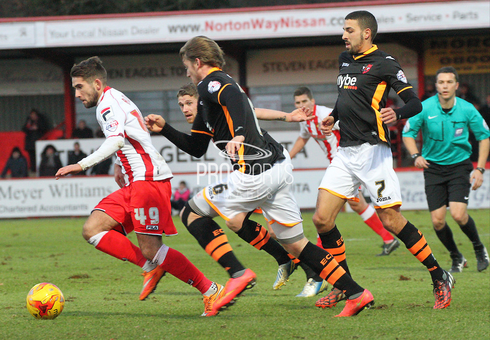 Charlie Adams is chased by Liam Sercombe, Christian Ribeiro and Danny Butterfield during the Sky Bet League 2 match between Stevenage and Exeter City at the Lamex Stadium, Stevenage, England on 20 December 2014. Photo by Kieran Clarke.