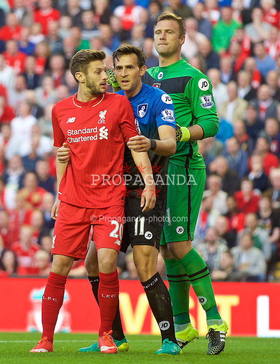 LIVERPOOL, ENGLAND - Monday, August 17, 2015: Liverpool's Adam Lallana with AFC Bournemouth's Charlie Daniels and goalkeeper Artur Boruc during the Premier League match at Anfield. (Pic by David Rawcliffe/Propaganda)