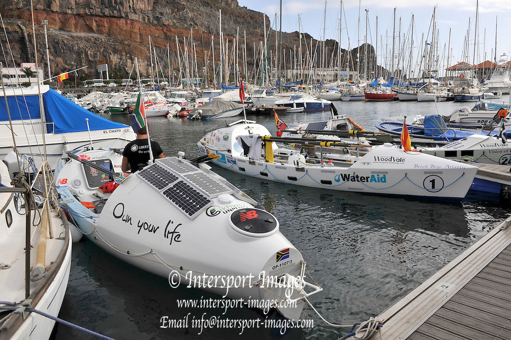 La Gomera, Canary Islands, Crews loading stores and preparing for the start of the 2009 Woodvale Atlantic Rowing Race. [Start delayed from Dec 6th 2009] 11:19:31,  Monday,  04/01/2010.  [Mandatory Credit. Peter Spurrier/Intersport Images]