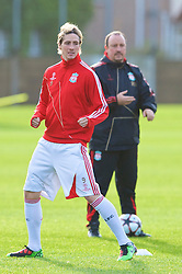 LIVERPOOL, ENGLAND - Tuesday, December 8, 2009: Liverpool's Fernando Torres and manager Rafael Benitez during a training session at Melwood ahead of the UEFA Champions League Group E match against AFC Fiorentina. (Pic by David Rawcliffe/Propaganda)