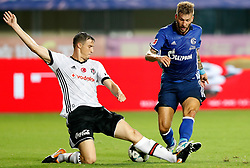 ZHUHAI, July 19, 2017  Guido Burgstaller (R) of FC Schalke 04 vies for the ball during a pre-season soccer match between Bundesliga's FC Schalke 04 and Turkish Super League champion Besiktas JK at Zhuhai Sports Center Stadium in Zhuhai, south China's Guangdong Province, on July 19, 2017. FC Schalke 04 won 3-2. (Credit Image: © Wang Lili/Xinhua via ZUMA Wire)