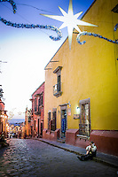 A mariache plays his guitar on a main street in San Miguel de Allende, Mexico on Christmas eve