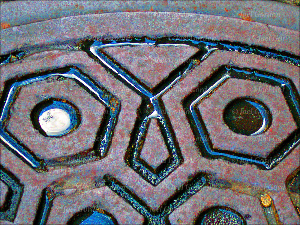 Close up of pattern and design of street manhole cover