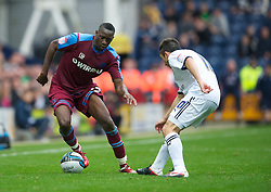 PRESTON, ENGLAND - Saturday, September 24, 2011: Tranmere Rovers' Lucas Akins and Preston North End's Barry Nicholson during the Football League One match at Deepdale. (Pic by Dave Kendall/Propaganda)
