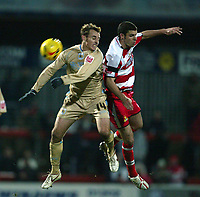 Photo: Aidan Ellis.<br /> Doncaster Rovers v Bristol City. Coca Cola League 1.<br /> 26/11/2005.<br /> Bristol's Luke Wilkshire battles with Doncaster's Lewis Guy