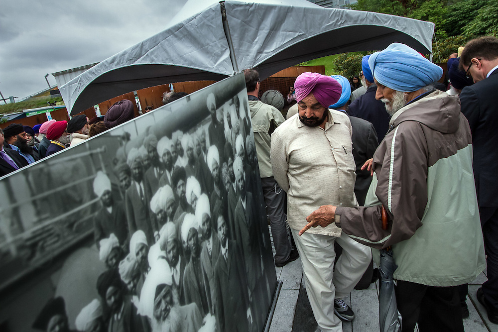 Vancouver, Canada: Men admire the newly installed memorial to the Komagata Maru, a ship carrying 376 passengers, mostly Sikhs from Punjab who sailed from Hong Kong to Canada in 1914 and were not allowed to land. The vessel waited in the harbor for two months while conditions aboard detoriated before being forced out to sea by the British navy. In the end, only 20 passengers were admitted to Canada, since the ship had violated the exclusion laws, designed to limit immigration from Asia.