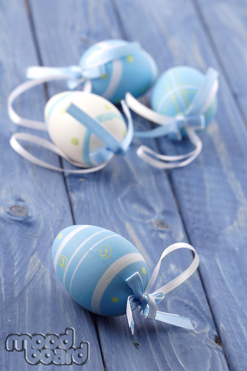 Blue and pink easter eggs on blue background