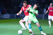 Adam Rooney of Salford City (9) and Matty Kosylo of Halifax Town (7) battle for the ball during the Vanarama National League match between Salford City and FC Halifax Town at Moor Lane, Salford, United Kingdom on 14 August 2018.