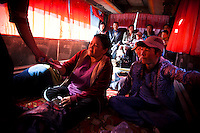 Passengers pay for riding fee inside a bus, which is 14-straight hour drive from Aralsk to Shymkent, the capital city of South Kazakhstan Province.