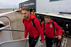 CARDIFF, WALES - Monday, September 4, 2017: Wales' Aaron Ramsey and Chris Gunter boards the team plane as the squad depart Cardiff Airport to travel to Chișinău ahead of the 2018 FIFA World Cup Qualifying Group D match against Moldova. (Pic by David Rawcliffe/Propaganda)