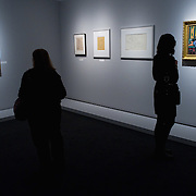 "BRESCIA, ITALY - FEBRUARY 11:  Visitors admire paintings and drawings of the Odalisques serie by Matisse at the  Santa Giulia Museum on February 11, 2011 in Brescia, Italy. The exhibition ""Matisse La Seduzione di Michelangelo"" shows  180 works of the French artist and will stay open until June 12th 2011"