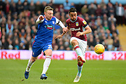 Aston Villa defender Neil Taylor (3) clears under pressure from Ipswich Town striker Freddie Sears (20) during the EFL Sky Bet Championship match between Aston Villa and Ipswich Town at Villa Park, Birmingham, England on 26 January 2019.