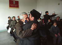 Tilganga Eye Surgery Workshop North Korea 2005. <br /> Han Mong Guk 80 embraces his son with excitement after his patch is removed and he sees him for the first time in 10 years. Bilaterally blind patients impose an extra presure on families as they are unable to look after themselves and need constant care.&copy; Michael Amendolia