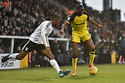 Fulham defender Denis Odoi (4) and Burton Albion striker Lucas Akins (10) battle for the ball during the EFL Sky Bet Championship match between Fulham and Burton Albion at Craven Cottage, London, England on 20 January 2018. Photo by Richard Holmes.