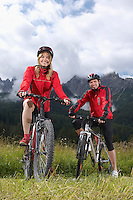 Couple on bikes in countryside portrait