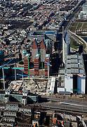 Nederland, Zuid-Holland, Den Haag, 20-03-2009; onder in beeld het Bernhardviaduct met zicht op bouwkranen van de JuBi-bouwput (dubbelministerie Justitie en Binnenlandse zaken), naast het ministerie van VROM. Miden de dubbele torenns van Castalia, bijgenaamd de Haagse Tieten (ministerie VWS) en rechts de Hoftoren (ministerie OCW). View on The Hague. The cranes of the construction site of the two Ministries of Justice and Interior. The blue roofed twin buildings are called The Tits of The Hague, residence of the Ministry of Health. .Swart collectie, luchtfoto (toeslag); Swart Collection, aerial photo (additional fee required); .foto Siebe Swart / photo Siebe Swart