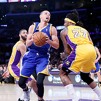 11 April 2014: Golden State Warriors guard Stephen Curry (30) drives past Los Angeles Lakers forward Jordan Hill (27) during the Golden State Warriors 112-95 victory over the Los Angeles Lakers at the Staples Center, Los Angeles, California, USA.