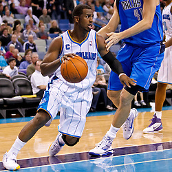 November 17, 2010; New Orleans, LA, USA; New Orleans Hornets point guard Chris Paul (3) drives past Dallas Mavericks power forward Dirk Nowitzki (41) of Germany during the second half at the New Orleans Arena. The Hornets defeated the Mavericks 99-97. Mandatory Credit: Derick E. Hingle