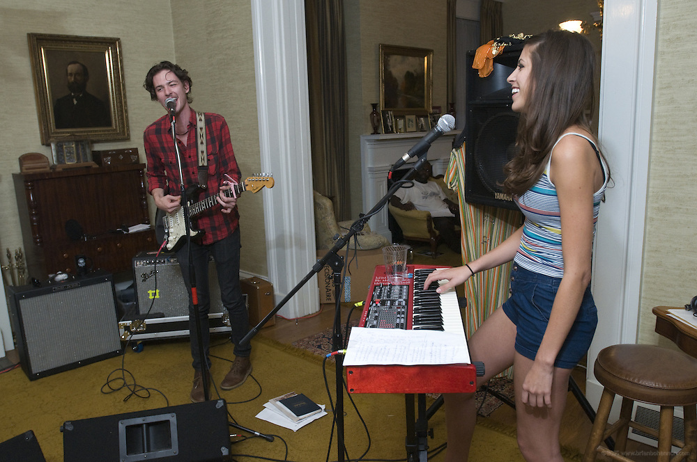 Houndmouth guitarist Matt Myers and keyboardist Katie Toupin practice at the home of drummer Shane Cody, Friday, Aug. 17, 2012, in New Albany, Ind. The group, which also includes bassist Zak Appleby, gained national attention after they uploaded their songs to the Internet earlier this year. Houndmouth's online success story is an indicator of how the music business is changing, and how the Louisville music scene continues to thrive.