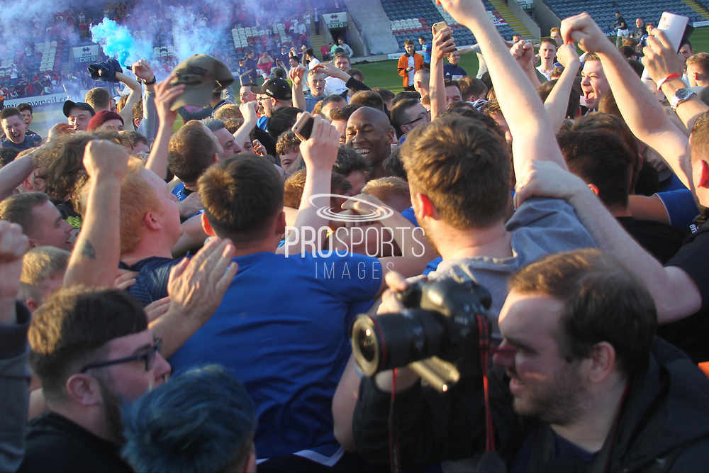 Rochdale players are mobbed on the pitch during the EFL Sky Bet League 1 match between Rochdale and Charlton Athletic at Spotland, Rochdale, England on 5 May 2018. Picture by Daniel Youngs.