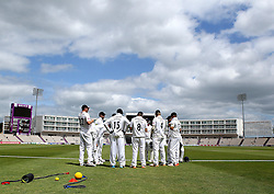 Hampshire prepare to go out and field for the second session on day one of their County Championship match with Somerset - Photo mandatory by-line: Robbie Stephenson/JMP - Mobile: 07966 386802 - 21/06/2015 - SPORT - Cricket - Southampton - The Ageas Bowl - Hampshire v Somerset - County Championship Division One