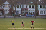 As the UK Prime Minister Boris Johnson suffers from Coronavirus and remains in intensive care in hospital - and a record 938 UK daily deaths were recorded, a total of 7,097, Londoners keep to government guidelines for daily exercise and practice social distancing in Ruskin Park, a green space in Herne Hill, Lambeth, on 8th April 2020, in south London, England.