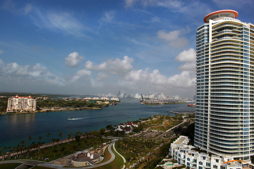 Aerial view from Ocean. Contimuum Condominium frames right side of frame, Government Cut and Fisher Island on left with downtown Miami in the background.