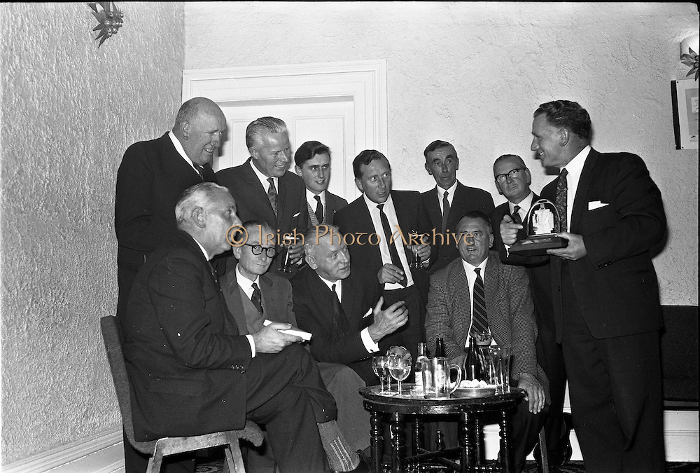 01/07/1963<br /> 07/01/1963<br /> 01 July 1963<br /> W.D. & H.O. Wills LTD., handing over trophy to Glenageary Horse Show Committee at the Royal Marine Hotel, Dun Laoghaire. A prize fund cheque of £300  and silver trophy for the winner of the Gold Flake Stakes were presented to the committee. Picture shows: Mr L.J. Doyle, (Horse Show Committee) on the right, showing the trophy to Mr D.A. Williams, (Representative, Wills); Mr J.F. Deigham (Committee); Mr Cecil V. Quigley (Committee); Mr W.J. Smith, Honorary Treasurer. BACK: Mr E.J. Kane; Mr Noel McMahon; Mr Colin Molohan; Mr J. Lawless; Mr D. O'Riordain and Mr F. Modkinson, all members of the committee.
