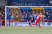 Russell Penn (captain) of York City FC scores to make it 0-1 to York City during the Sky Bet League 2 match between AFC Wimbledon and York City at the Cherry Red Records Stadium, Kingston, England on 19 March 2016. Photo by Stuart Butcher.