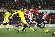 Brentford midfielder John Swift battling for ball with Leeds United midfielder Luke Murphy during the Sky Bet Championship match between Brentford and Leeds United at Griffin Park, London, England on 26 January 2016. Photo by Matthew Redman.