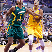 15 August 2014: Los Angeles Sparks forward/center Sandrine Gruda (7) vies for the rebound with Seattle Storm forward/center Crystal Langhorne (1) during the Los Angeles Sparks 77-65 victory over the Seattle Storm, at the Staples Center, Los Angeles, California, USA.