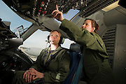 U.S. Air Force pilots conduct their preflight checklist during engine start up on the flightdeck...Air Force aircraft transport most of the supplies and military equipment to the combat zone. Specialists must weigh, sort and load all of the gear before it heads to its location abroad. Air Force loadmasters and pilots ensure the safe transport of all equipment required in the field.