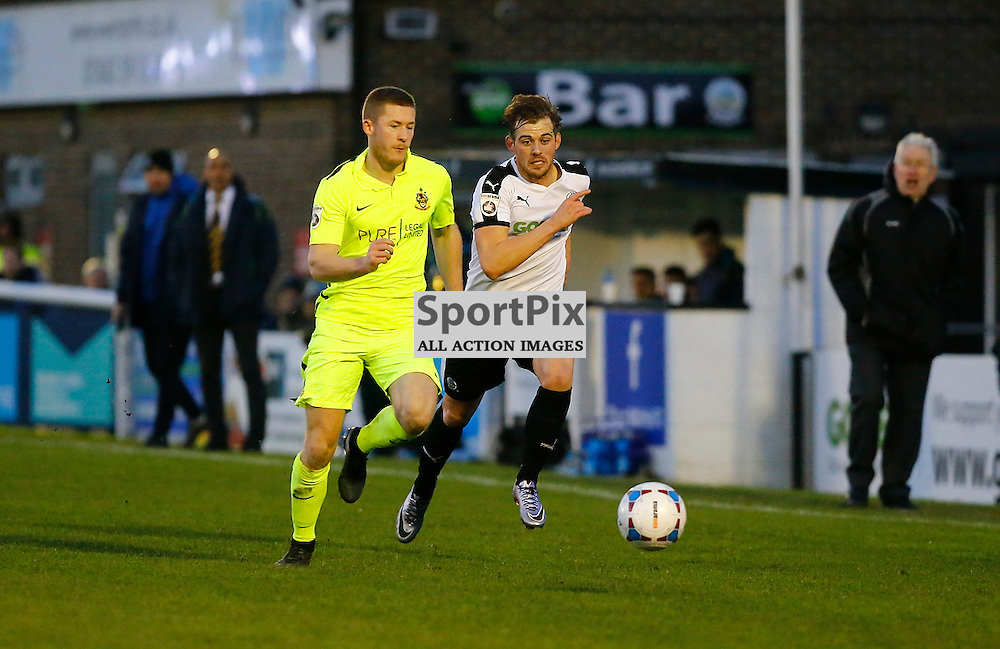 Dover's winger Tom Murphy (10) and Southports Matthew Challoner race for the ball. Dover Athletic against Southport FC in the FA Trophy. 16 January 2016. (c) Matt Bristow | SportPix.org.uk