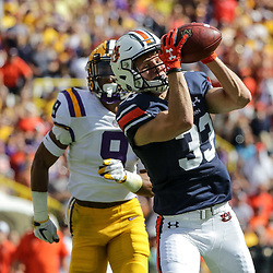 Oct 14, 2017; Baton Rouge, LA, USA; Auburn Tigers wide receiver Will Hastings (33) catches a touchdown over LSU Tigers safety Grant Delpit (9) during the first quarter of a game at Tiger Stadium. Mandatory Credit: Derick E. Hingle-USA TODAY Sports