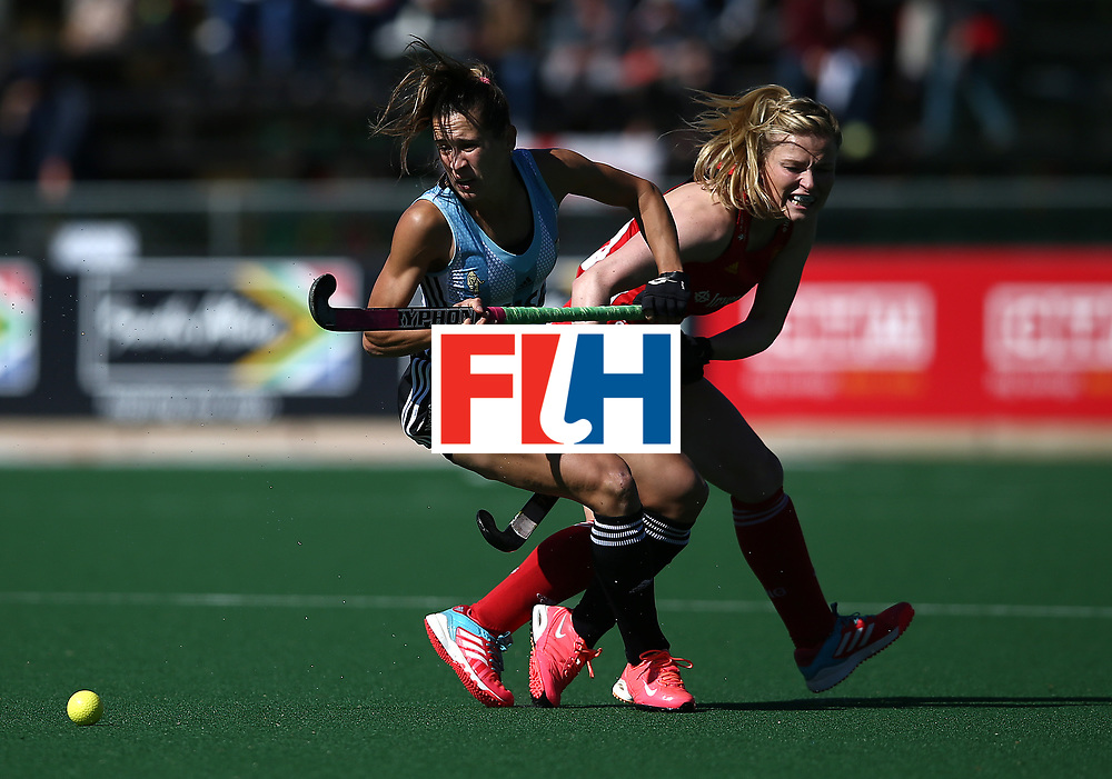 JOHANNESBURG, SOUTH AFRICA - JULY 23:  Martina Cavallero of Argentina battles with Hollie Webb of England during day 9 of the FIH Hockey World League Women's Semi Finals 3rd/ 4t place match between England and Argentina at Wits University on July 23, 2017 in Johannesburg, South Africa.  (Photo by Jan Kruger/Getty Images for FIH)