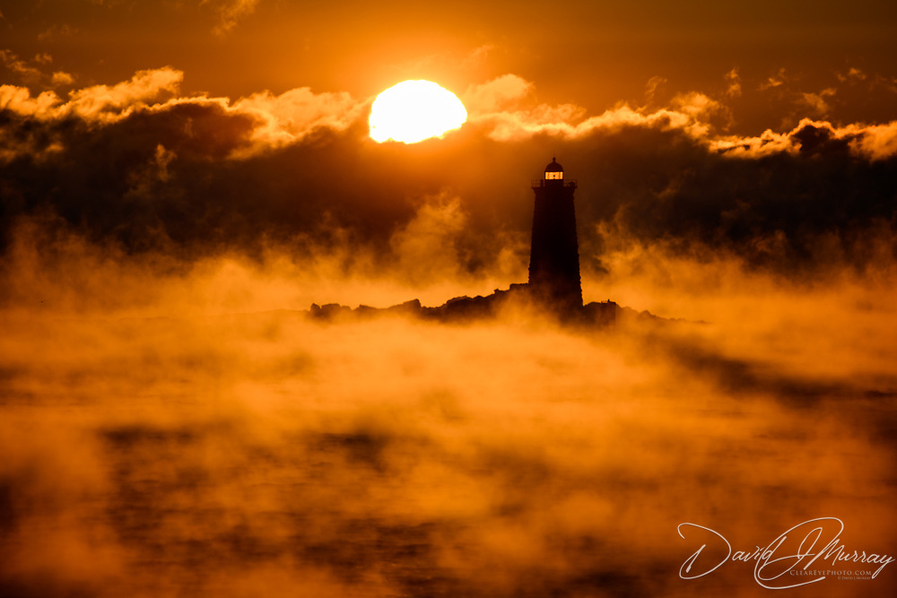 Sea smoke at Whaleback Light. Taken at sunrise from New Castle, NH. Tempurature was minus 5 degrees F, with wind chill fluctuating between -20 and -30.